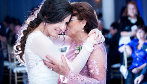 mom dancing with daughter at her wedding